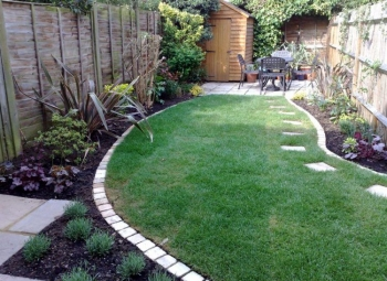 Edged-Lawn-and-Flower-Beds-with-Small-Patio