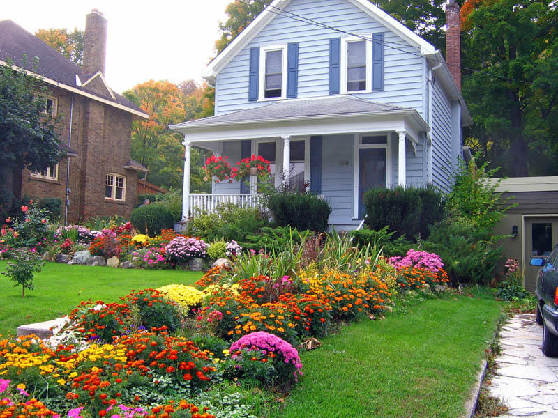 fall landscaping ideas layers of flowers