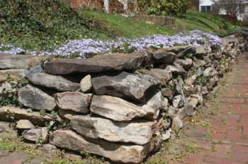 landscaping stone retaining wall around flower bed