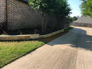 After - Landscaping Flower Bed Stone Borders